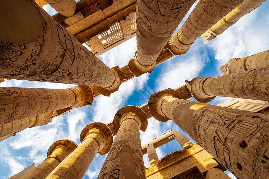 Karnak Hypostyle hall columns and clouds in the Temple at Luxor Thebes