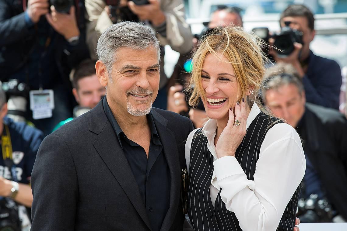 """Джордж Клуни, Джулия Робъртс присъстват на представянето на """"Пулсът на парите"""" на ежегодния 69-и филмов фестивал в Кан в Palais des Festival..."""